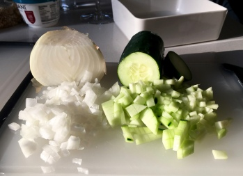finely chop the onion and cucumber